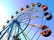Multicolored little ferris wheel against the sky stock photography