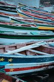 Multicolored local fishing boats waiting on the coast of good weather. Ponta do Sol Santo Antao Cape Verde.  Royalty Free Stock Image