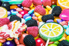 Multicolored lollipops, candy and chewing gum. Background stock photo