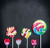 Multicolored lollipops, candy and chewing gum royalty free stock photos