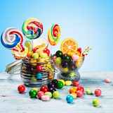 Multicolored lollipops, candy and chewing gum Stock Photos