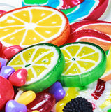 Multicolored lollipops and chewing gum royalty free stock photos