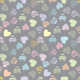 Multicolored love hearts on a gray  background. Vector seamless pattern. Stock Photography