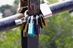 Multicolored love locks, locked on a rusty pipe. Symbol of love and loyalty stock photos