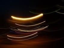 Multicolored luminous lines. Black background with multicolored luminous lines Stock Image