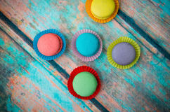 Multicolored macaroon on blue table Stock Images