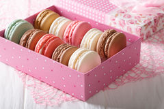Multicolored macaroons in a gift box close-up. Horizontal Royalty Free Stock Images