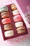 Multicolored macaroons in a gift box close-up on a table. Vertic Stock Photography