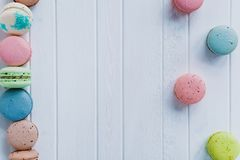 Multicolored macaroons or macaron on a white wooden background, copy space. Multicolored macaroons or macaron on a white wooden background, copy space Stock Photography
