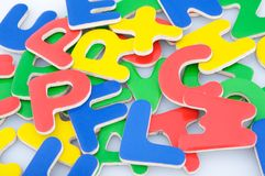 Multicolored magnetic letters Stock Images