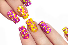 Multicolored manicure with dots. Royalty Free Stock Photography