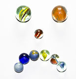 Multicolored Marbles Sad Face on white background Stock Photos