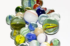 Multicolored Marbles on white background Royalty Free Stock Photos