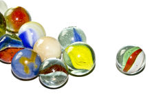 Multicolored Marbles on white background Royalty Free Stock Photo