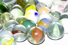Multicolored Marbles on white background Royalty Free Stock Image