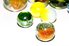 Multicolored Marbles on white background Stock Photos