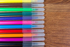 Multicolored markers close-up laid out on the table. Stationery. Royalty Free Stock Photo