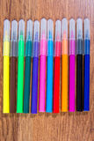Multicolored markers close-up laid out on the table. Stationery. Stock Photography