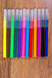 Multicolored markers close-up laid out on the table. Stationery. Stock Photos