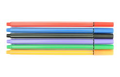 Multicolored markers on white background Royalty Free Stock Photos