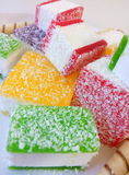 Multicolored marmalade sliced in pieces on a white plate Royalty Free Stock Photography