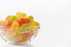 Multicolored marmalade sweets. In a glass plate on a white background Royalty Free Stock Photography