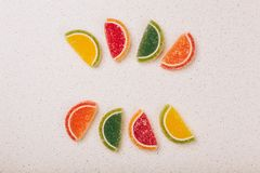 Multicolored marmalade sweets. Lie on a gray table top Royalty Free Stock Images