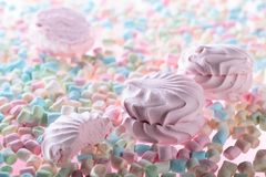 Multicolored marshmallows on pink background . Royalty Free Stock Images