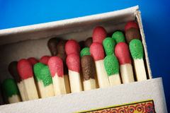 Multicolored matchsticks in the box Stock Photos