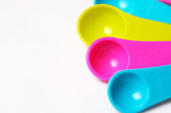 Multicolored measuring spoons. Stock Photos