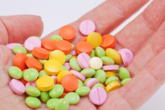 Multicolored medical pills on hand Stock Photography