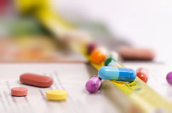 MULTICOLORED MEDICINE CAPSULES AND TABLETS Royalty Free Stock Image