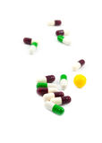 Multicolored medicine pills. Multicolored defocused medicine pills on the white Royalty Free Stock Image