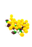 Multicolored medicine pills. On the white background Royalty Free Stock Image
