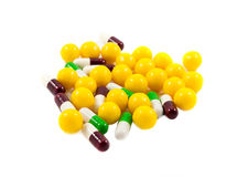 Multicolored medicine pills. On the white background Royalty Free Stock Photo