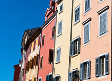 Multicolored Mediterranean buildings. Multicolored Mediterranean building facades. Old historical architecture of small Croatian town Stock Photos