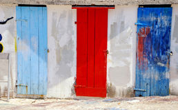 Multicolored mediterranean run-down doors. Three ancient multicolored run-down mediterranean doors (Montenegro Royalty Free Stock Photo