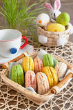 Multicolored meringues macaroons in a basket for Easter Royalty Free Stock Image