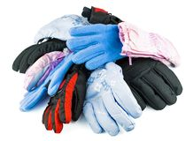 Multicolored mixed ski gloves. Varied in size isolated on white background Royalty Free Stock Photography