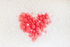 Red heart on white soap bubbles royalty free stock photo