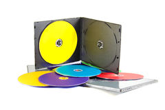 Multicolored musical CD disks on white background stock image