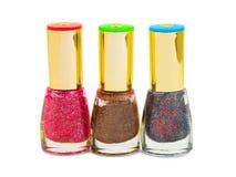 Multicolored nail polish bottles Stock Images