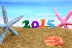 Multicolored new year 2015. On the beach Royalty Free Stock Image
