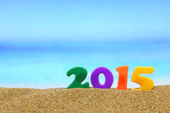 Multicolored new year 2015. On the beach Stock Images