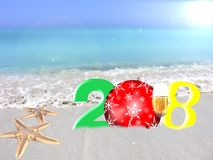 Multicolored New Year 2018. Happy new year 2018. Greeting card 2018 on a tropical background, on the ocean shore Royalty Free Stock Photo
