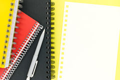 Multicolored notepads, mechanical pencil and blank page of paper Stock Photography