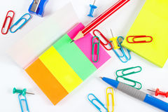 Multicolored office stationery on white desktop closeup Stock Photos