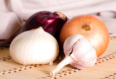 Multicolored onion and clove garlic Royalty Free Stock Photo