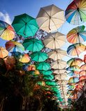 Colorful umbrellas as street decoration at Nicosia, Cyprus. Protection from sun and rain. Multicolored open umbrellas decorate a narrow street at Nicosia Stock Photography