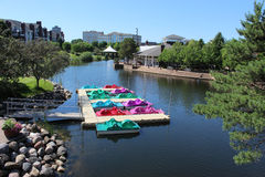 Multicolored Paddle Boats on a Lake Royalty Free Stock Photo